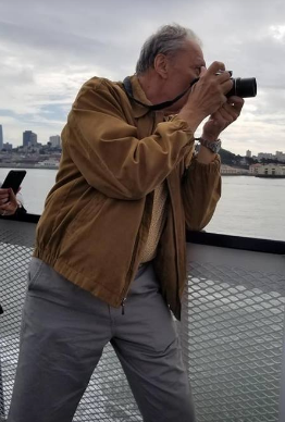 Roman capturing the beauty of San Francisco on our Bay Cruise.